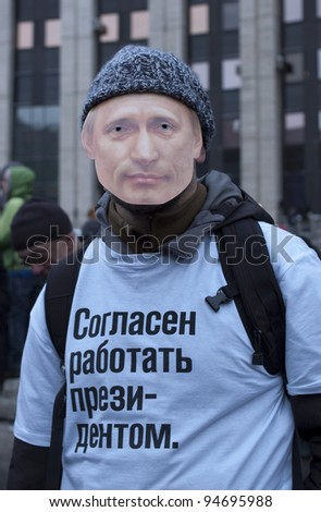 "MOSCOW - DECEMBER 24: Protester against the election results with Putin's mask on his face and text on his t-shirt: ""I am ready to work as a President"". December 24, 2011 in Moscow, Russia."