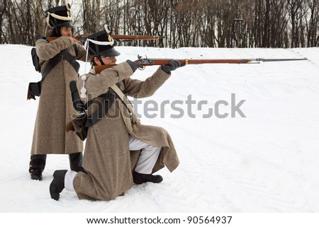 "MOSCOW - FEB 27: Two soldiers take aim at historical reconstruction, Feb 27, 2011, Moscow, Russia. Municipality of Lefortovo and ""Moscovskoe opolchenie"" had historical festival ""Lefortovo maneuvers""."