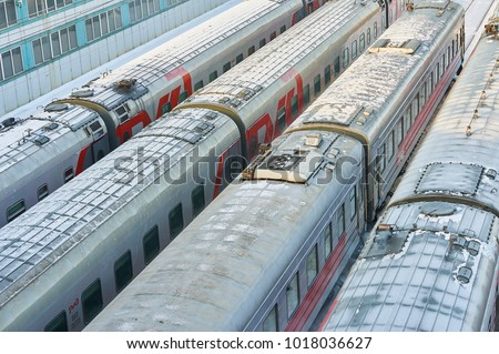 MOSCOW, FEB. 01, 2018: Winter view on railway passenger coaches cars at rail way depot under snow Passenger trains coaches cars in depot Snow covered russian railways RZD passenger trains. Many trains