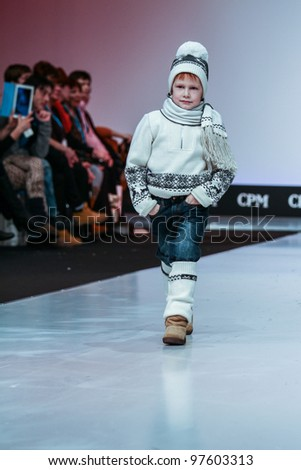 MOSCOW-FEBRUARY 29: An unidentified child wears Gakkard clothing collection at the international exhibition of  the fashion industry, Collection Premiere Moscow, CPM on February 29, 2012 in Moscow, Russia.