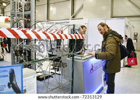 MOSCOW - FEBRUARY 16: Barbed Razor Wire presented at the International Exhibition Security and Safety Technologies February 16, 2011 in Moscow. - stock photo