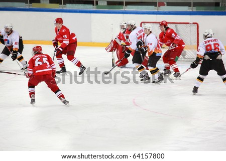 "MOSCOW - FEBRUARY 20: Hockey match ""Spartak"" -""Severstal&qu ot; on ice field in sports palace ""Sokolniki&quo t; February 20, 2010 in Moscow, Russia. The dangerous moment at ""Spartak""  net. - stock photo"