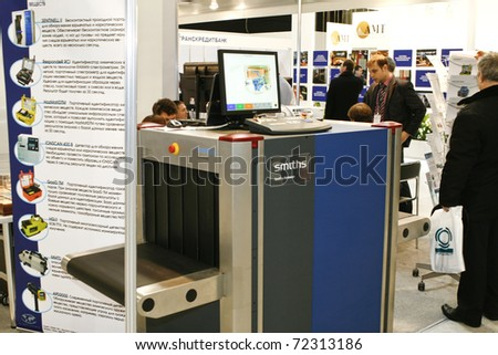 MOSCOW - FEBRUARY 16: Security check with metal detector X-ray presented at the International Exhibition Security and Safety Technologies February 16, 2011 in Moscow.