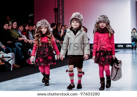 MOSCOW-FEBRUARY 29: Unidentified children wear Condor clothing collection at the international exhibition of  the fashion industry, Collection Premiere Moscow, CPM on February 29, 2012 in Moscow, Russia.