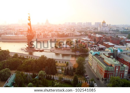 Moscow in the sunset light - General view from the top of the merging of the Moscow River and the Bypass canal in Moscow, monument to Peter I (left), The Cathedral of Christ the Savior (right)