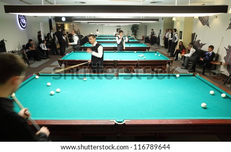 MOSCOW-JAN 21:Unidentified participants of Moscow championship billiard take part in competition at a snooker center SC in Olimpiysky, Jan 21, 2012 Moscow, Russia.15 participants took part.