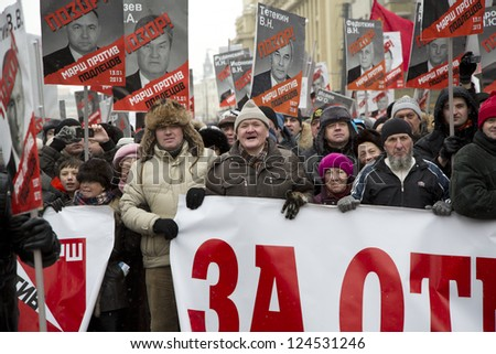 MOSCOW-JAN13:View of people on March Against Adoption Ban in Moscow on Jan 13,2013.People held march in Moscow to protest a recently adopted law that bans adoption of Russian children by US citizens