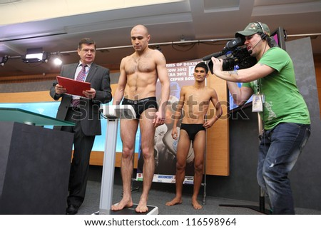 MOSCOW - JAN 12: Weighing boxers on press conference of World Series of Boxing between Dynamo Moscow-Bangkok Elephants in Press Center RTR on Jan 12, 2012 in Moscow, Russia.