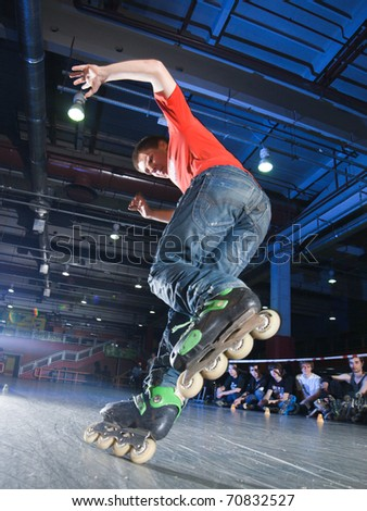 MOSCOW - JANUARY 22: Adrenaline skatepark, Anton Moiseev performs a Onefoot before slide - Roller Adrenaline Night shuffle competition on January 22, 2011 in Moscow