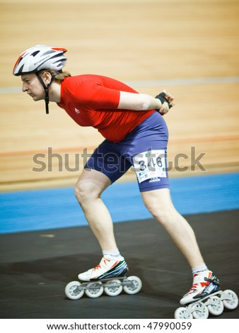 MOSCOW - JANUARY 08: Olympic bicycle arena, Alexander Komantsev runs the race, shallow DOF, little motion blur - Annual Christmas Run on January 08, 2010 in Moscow