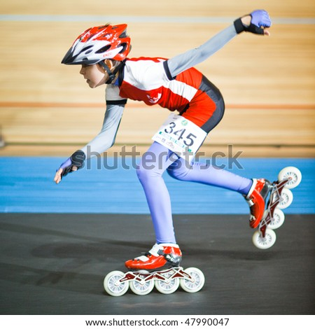 MOSCOW - JANUARY 08: Olympic bicycle arena, Roman Klochkov runs the race, shallow DOF, little motion blur - Annual Christmas Run on January 08, 2010 in Moscow - stock photo