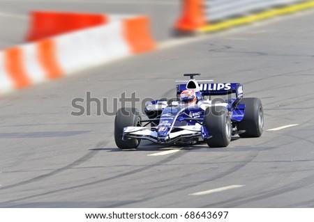 MOSCOW - JULY 19: Kazuki Nakajima of AT&T Williams at Bavaria Moscow City Racing 2009 at Kremlin embankment July 19, 2009 in Moscow
