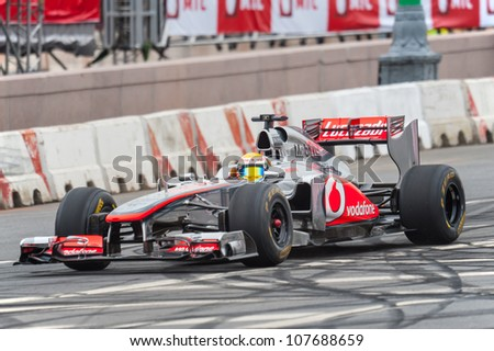 MOSCOW - JULY 15: Lewis Hamilton of McLaren Mercedes at Moscow City Racing 2012 at Kremlin embankment July 15, 2012 in Moscow