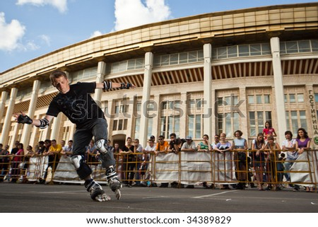 MOSCOW - JULY 25: Luzhniki Olympic Arena, Rollerskater Andrey Antonov (Russia) performes Wheel Barrow slide element - Russian Rollerskating Federation Championship on July 25, 2009 in Moscow