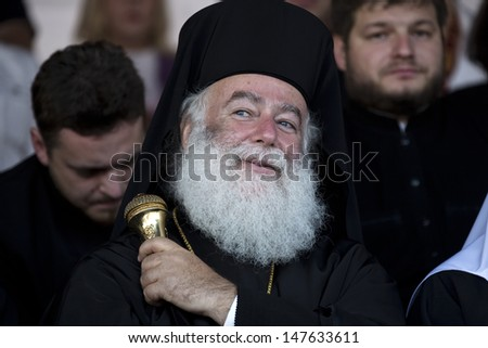 MOSCOW - JULY 25: Orthodox Patriarch of Alexandria and all Africa Theodore II is watching the concert at Red Square of the 1025th anniversary of Orthodox Christianity in Russia on 25 july of 2013.