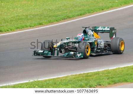 "MOSCOW - JULY 14: Vitaly Petrov of Caterham F1 Team at opening new circuit ""Moscow Raceway"" July 14, 2012 in around Moscow, Russia"