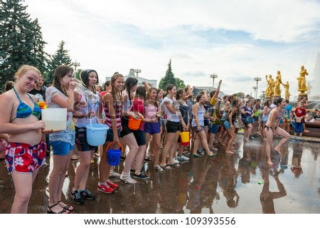 "MOSCOW - JULY 14: Young people ready for shooting and throwing water at each other during flash mob ""Water Battle"" near Peoples Friendship Fountain in VDNKH on July 14, 2012 in Moscow, Russia"