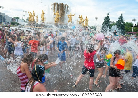 "MOSCOW - JULY 14: Young people shooting and throwing water at each other during flash mob ""Water Battle"" near Peoples Friendship Fountain in VDNKH on July 14, 2012 in Moscow, Russia"
