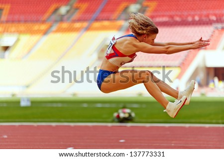 MOSCOW - JUN 11: Female athlete makes long jump at Grand Sports Arena of Luzhniki OC during International athletics competitions IAAF World Challenge Moscow Challenge, June 11, 2012, Moscow, Russia.