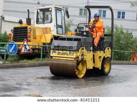 MOSCOW - JUNE 22: Brigade of workers repairs road under the program of planned repair in  Marino on June 22, In the government of Moscow have planned to repair in 2011 24,6 million in sq.m. of roads