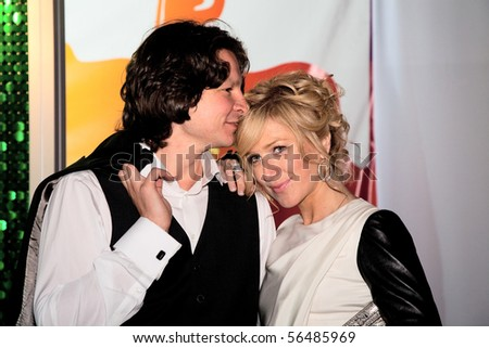 MOSCOW - JUNE 17: Maxim Shabalin and Russian actress Irina Grineva. Afterparty Opening ceremony of 32st Moscow International Film Festival on June 17, 2010 in Moscow, Russia