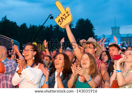 MOSCOW - JUNE 16: People cheering at open-air concert on X International Jazz Festival \