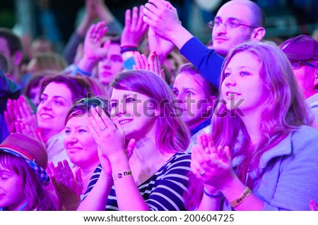 MOSCOW - JUNE 14: People cheering at open-air concert on XI International Jazz Festival \