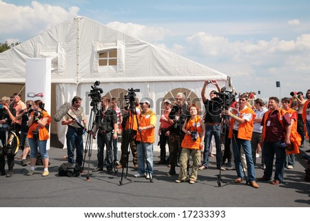"""MOSCOW - JUNE 22: Photographers and press on The second stage of the Championship of Russia June 22, 2008 in autodrome """"Miachkovo"""", Moscow."""
