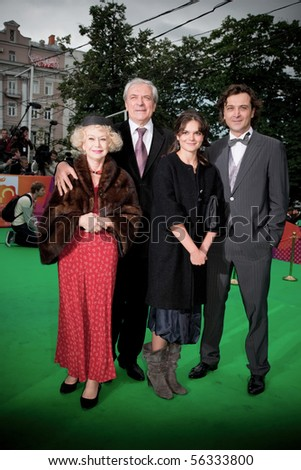 MOSCOW -JUNE,17:Russian actor Alexander Lazarev and Svetlana Nemolyaeva with family. Opening Ceremony Of 32st Moscow International Film Festival at Pushkinsky Cinema . June 17, 2010 in Moscow, Russia.