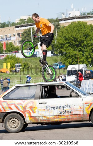 """MOSCOW - JUNE 6 : Stuntman Valeriy Shkan on his bicycle does a trick at """"Stuntman show"""" on June 6, 2008 in Moscow."""