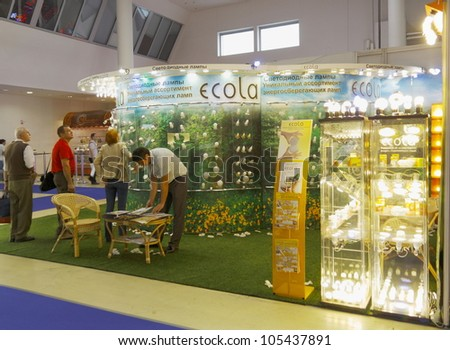 MOSCOW-JUNE 15:The stand of the Russian company ECOLA production of LED and fluorescent energy saving lamps at the international exhibition ELEKTRO'2012 on June 15, 2012 in Moscow - stock photo