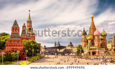 Photo of  Moscow Kremlin and of St Basil's Cathedral on Red Square, Moscow, Russia. Ancient Moscow Kremlin is the main tourist attraction of city. Beautiful panoramic view of the heart of Moscow on sunny day.