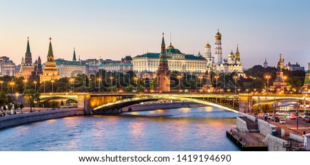 Moscow Kremlin at Moskva River, Russia. Beautiful view of the famous Moscow city center in summer. Panorama of old Moscow Kremlin and Bolshoy Kamenny Bridge at sunset. Moscow cityscape in evening.