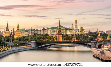Moscow Kremlin at Moskva River, Russia. Panorama of old Moscow in summer evening. Scenic warm view of the ancient Moscow Kremlin at sunset. Beautiful cityscape of the famous Moscow center.  #1437279731