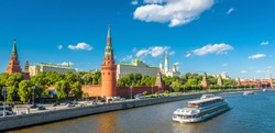Moscow Kremlin in summer, Russia. Famous Moscow Kremlin is a top tourist attraction of city. Panoramic view of the beautiful Moscow landmark. Cityscape of the Moscow center and ship on Moskva River.