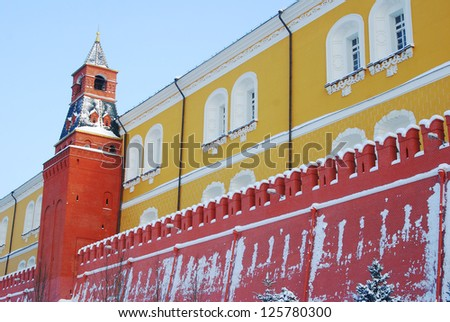 Moscow Kremlin wall and tower in winter.