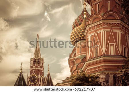 Moscow Kremlin with St Basil`s Cathedral on Red Square, Russia. This place is a top tourist attraction of Moscow. Vintage photo of the old Moscow landmarks. Ancient architecture of Moscow.
