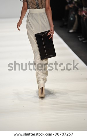 MOSCOW - MARCH 25: A Model walks runway at the Basharatian for Fall Winter 2012 presentation during MBFW on March 25, 2012 in Moscow, Russia
