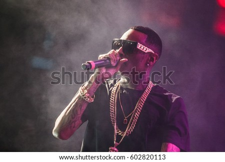 MOSCOW-27,MARCH,2015:Concert of famous American hip hop celebrity,rap singer Soulja Boy performing on stage in nightclub.Popular rapper with microphone in hand.Rap star performer sing in radio mic
