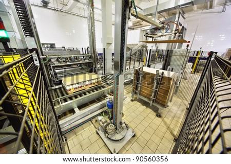 MOSCOW - MARCH 3: Machines packed milk bottles at Wimm-Bill-Dann plant, on March 3, 2011 in Moscow, Russia. PepsiCo has spent more than $6 billion to buy juice and dairy products Wimm-Bill-Dann.