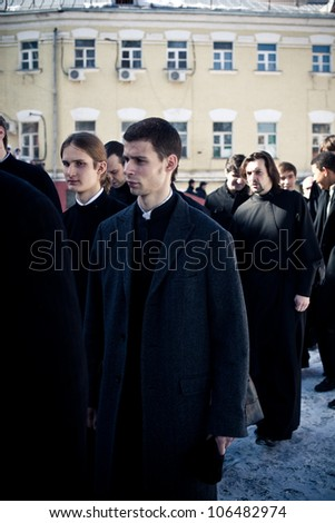 MOSCOW - MARCH 14: Monks and priests go from the church to dining room after  the orthodox liturgy in High Monastery of St Peter on March 14, 2011 in Moscow