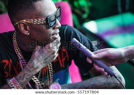 MOSCOW-27 MARCH,2015:Rap singer Soulja boy interview.Fashionable black tattooed guy talks in microphone.Hip hop celebrity,rap star in gold chains and covered with tattoos