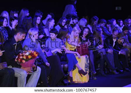 MOSCOW - MARCH 23: VIP guests at front row waiting for the Belarus Fashion Show Fall Winter 2012 runway show presentation during MBFW on March 23, 2012 in Moscow, Russia