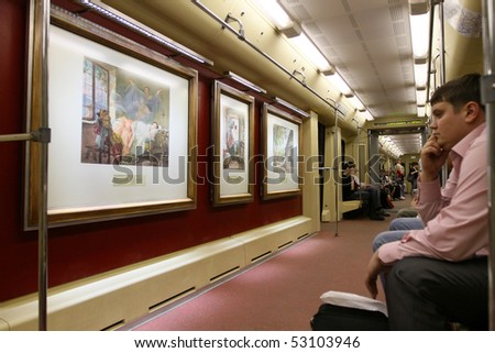 """MOSCOW - MAY 12: """"Aquarelle"""" subway train with a new collection of masterpieces by watercolor artists from the Russian Museum set out from Partizanskaya station, May 12, 2010 in Moscow, Russia."""
