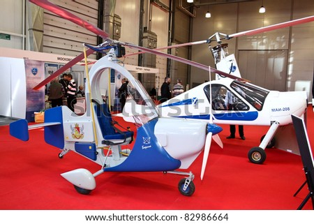 MOSCOW - MAY 19: Autogyro MAI-208 and Barsik at the international exhibition of  the helicopter industry, HeliRussia on May 19, 2011 in Moscow