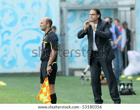MOSCOW - MAY 15: Dinamo head coach Miodrag Bozovic during a game of the 11th round of Russian Football Premier League - Dinamo Moscow vs. Alania Vladikavkaz - 2:0, May 15, 2010 in Moscow, Russia.