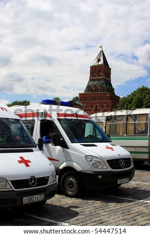 MOSCOW - MAY 29:Emergency ambulances stand by at Avon Walk for Breast Cancer at Red Square on MAY 29, 2010 in Moscow, Russia