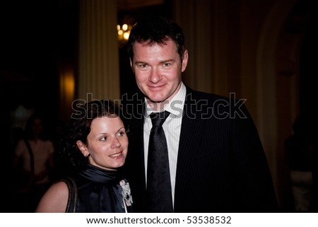 """MOSCOW - MAY 20: Figure skaters Maria Petrova and Alexei Tikhonov. Concert in memory Oleg Yankovsky. Festival Bosco di Ciliegi """"Cherry Forest"""".  May 20, 2010 in Moscow Conservatory. Moscow, Russia - stock photo"""