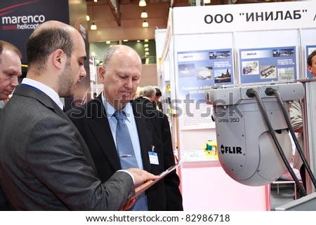 MOSCOW - MAY 19: Man shows Gyro-stabilized airborne camera systems at the international exhibition of  the helicopter industry, HeliRussia on May 19, 2011 in Moscow