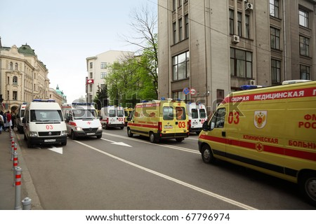 MOSCOW - MAY 6: Many yellow and white emergency ambulances rehearse for parade in honor of Great Patriotic War victory at street on May 6, 2010 in Moscow, Russia
